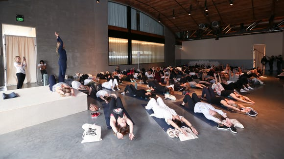 Women who purchased higher tiers of access sample an exercise class during Gwyneth Paltrow's health summit.