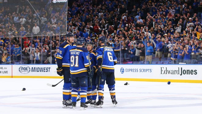 St. Louis Blues left wing Jaden Schwartz (17) is congratulated by teammates Vladimir Tarasenko (91), Colton Parayko (55) and  Joel Edmundson (6) after scoring his third goal of the game against the Chicago Blackhawks at Scottrade Center.