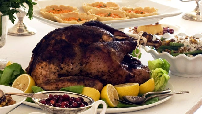 Turkey with all the fixins' is a popular Thanksgiving tradition.