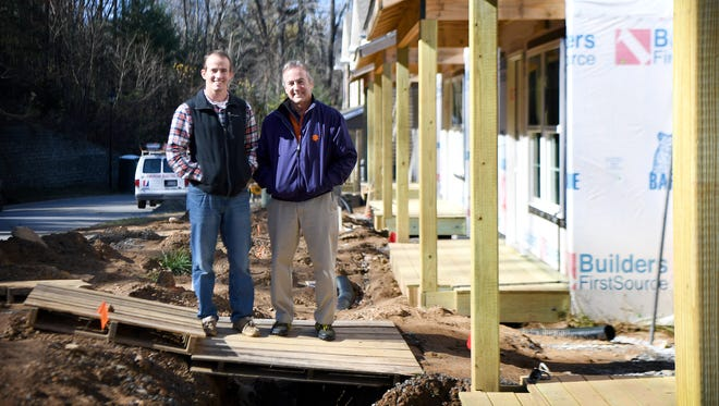Son and father team Kevin and Ken Jackson pose in the under construction portion of their development Mills Creek Condominiums on Monday, Nov. 20, 2017. The Jackson family has been building and developing properties in Western North Carolina for five generations.