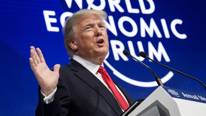 President Donald Trump delivers a speech during the World Economic Forum on Friday.