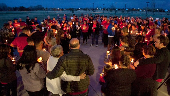 Family and friends gather for Hayden Dean Wood's candle light vigil held at Spring Canyon Park Tuesday evening.
