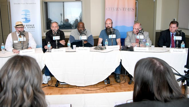 Sheriff candidates, from left, Rondell Lance, Chris Winslow, Quentin Miller, Tracey DeBruhl, R. Daryl Fisher, and Randy Smart participate in a forum at the Blue Ridge Public Radio studios hosted by the station as well as the Citizen Times on Monday, April 16, 2018.