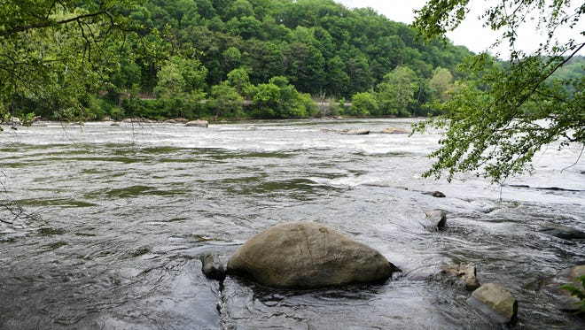 A view of the French Broad River at Ledges River Park where the body of a kayaker was recovered by emergency responders on Tuesday, May 15, 2018.