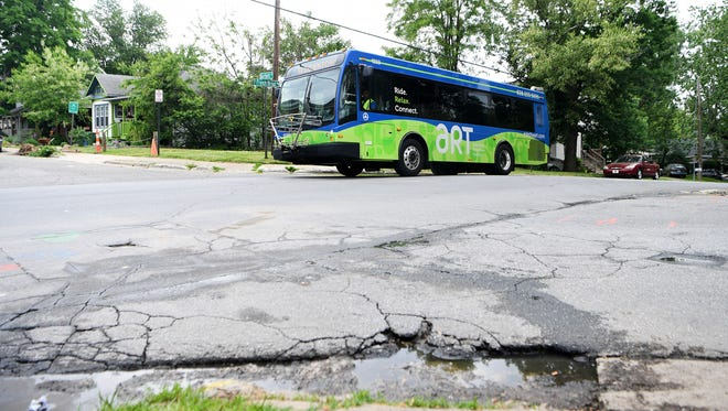 An Asheville city bus picks up residents from Bartlett Arms Apartments at the corner of Bartlett Street and South French Broad Avenue on Tuesday, May 15, 2018. Residents say that the distance to the stop, which has no shelter, is too far for the elderly and disabled that make up the majority of the population of the complex to travel to catch the bus.