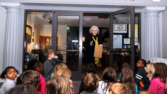 Vicky Ballard, executive director of the Colburn Earth and Science Museum in downtown Asheville, speaks with a group of school children on Tuesday. The museum is at 2 South Pack Square.