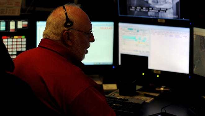 Dispatcher Max King assigns Emergency Medical Services to a 911 call Friday morning at the Buncombe County 911 Emergency Services Dispatch Center off Erwin Hills Road.