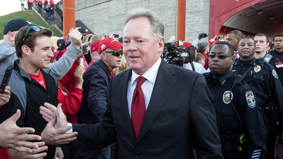 Coach Bobby Petrino greets the fans during the Cards March before the Florida State game. 10/30/14