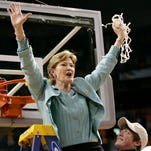 FILE - In this April 8, 2008, file photo, Tennessee coach Pat Summitt holds up the net as her son, Tyler, looks on after Tennessee beat Stanford 64-48 to win its eighth national women's basketball championship, at the NCAA women's basketball tournament Final Four in Tampa, Fla.  Summitt, the winningest coach in Division I college basketball history who uplifted the women's game from obscurity to national prominence during her career at Tennessee, died Tuesday morning, June 28, 2016. She was 64. (AP Photo/Gerry Broome, File)