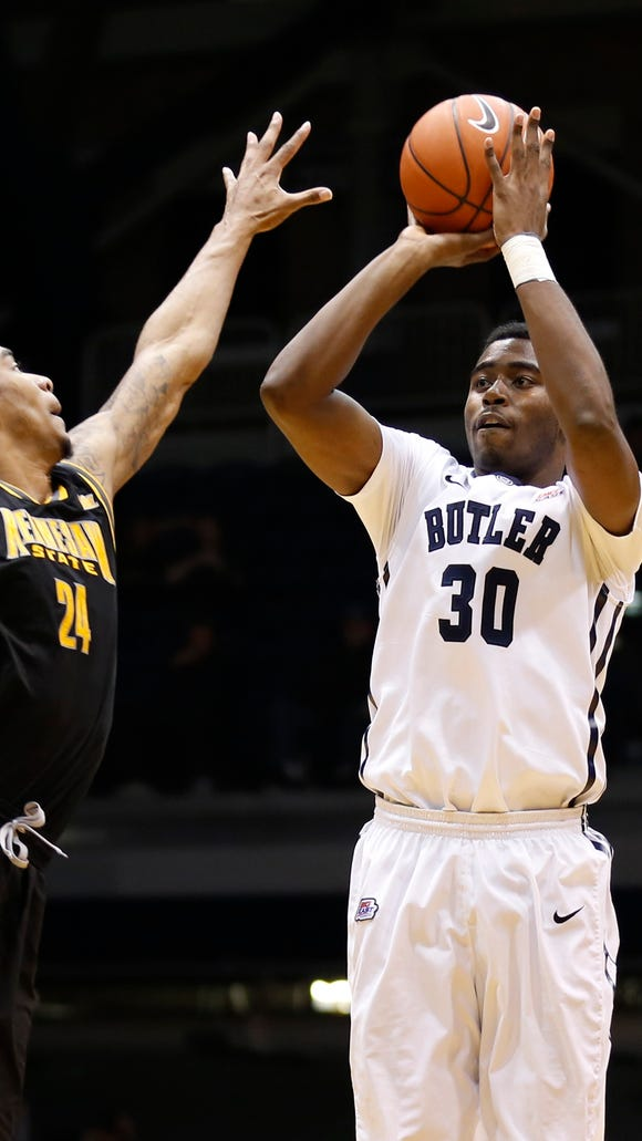 Butler's Kelan Martin shoots over Kennesaw State's Orlando Coleman in the second half of the teams' game on Dec. 8, 2014 at Hinkle Fieldhouse. Butler won 93-51.