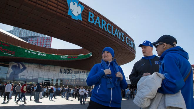 Duke fans are seen outside Barclays Center where the men's Atlantic Coast Conference NCAA college basketball tournament is taking place,  Thursday, March 9, 2017, in New York. ACC John Swofford insists bringing the league's storied men's basketball tournament to Brooklyn is not an experiment, but the start of a long-term relationship. Still, this is a long way to go for the hardcore hoops fans of the ACC's power schools, who have grown a bit possessive of this tournament down South. (AP Photo/Mary Altaffer)