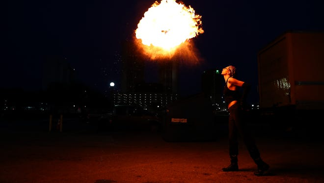 Viktoria Birr demonstrates fire breathing outside the Corpus Christi Caller-Times building on Tuesday, Feb. 27,2018.