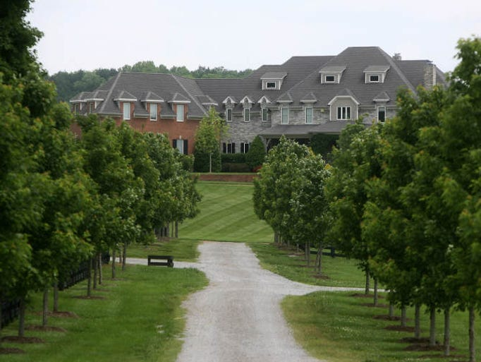 The entrance to the front exterior. Sheryl Crow's 150-acre Cross Creek Farm in the Bethesda community of Williamson County is on the market for $7.5 million as seen on Friday, May 14, 2010.