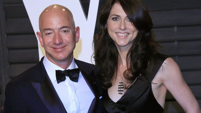 Amazon founder Jeff Bezos and wife MacKenzie Bezos arriving for the 2017 Vanity Fair Oscar Party following the 89th annual Academy Awards ceremony in Beverly Hills, Calif., Feb. 26, 2017.
