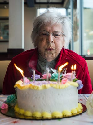 Nadine Baum blows out the candles on her cake Oct. 13, 2016, during her 100th birthday surprise party at McDonald's in Hanover, Pa.
