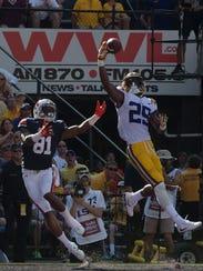 LSU corner back Andraez Williams (29) swats the ball