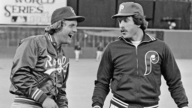 In this Oct. 14, 1980, file photo, Kansas City Royals slugger George Brett and Philadelphia Phillies home run champ Mike Schmidt (from left) laugh during warmups before the first game of the World Series in Philadelphia. The money, the scouting, the buzz was all different when Major League Baseball held its annual June draft a half-century ago. With this year's picking set to start Wednesday, Schmidt remembers how it was when he was chosen in 1971.