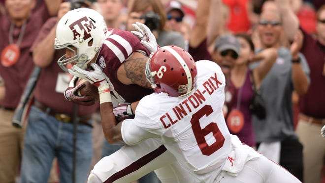 Texas A&M wide receiver Mike Evans (13) is grabbed by Alabama defensive back Ha Ha Clinton-Dix (6) during the first half of the Crimson Tide's victory Sept. 14 at Kyle Field.