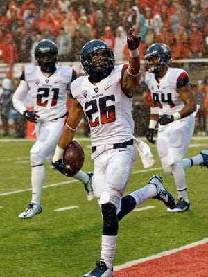 Arizona safety Jourdon Grandon celebrates after his interception in the second quarter during a game against Utah on Saturday, Nov. 22, 2014, in Salt Lake City.