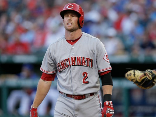 Cincinnati Reds Zack Cozart reacts to striking out during the third inning of a baseball game against the Texas Rangers in Arlington, Texas, Wednesday, June 22, 2016. (AP Photo/LM Otero)