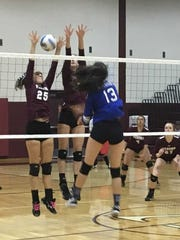 Millburn's Jessica Toledo punches a ball past two defenders