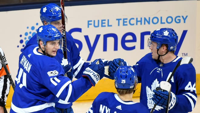 Toronto Maple Leafs forward Zach Hyman (11) is greeted by teammates after scoring against the Detroit Red Wings in the first period at Air Canada Centre.