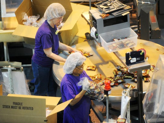 Workers package pretzels at Snyder's of Hanover in