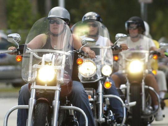 Motorcycles with helmets are seen in Palm Bay.
