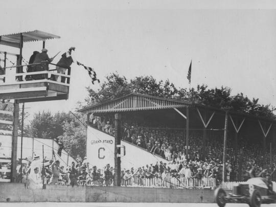 Louis Meyer takes the checkered flag in the 1936 Indianapolis 500 Mile Race