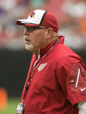 Cardinals head coach Bruce Arians watches over the team at practice during Cardinals Fan Fest in Glendale on Friday, August 2, 2014.