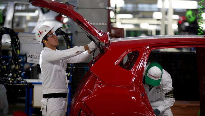 Employees at work in the new multibillion-dollar Honda car plant in Celaya, in the central Mexican state of Guanajuato