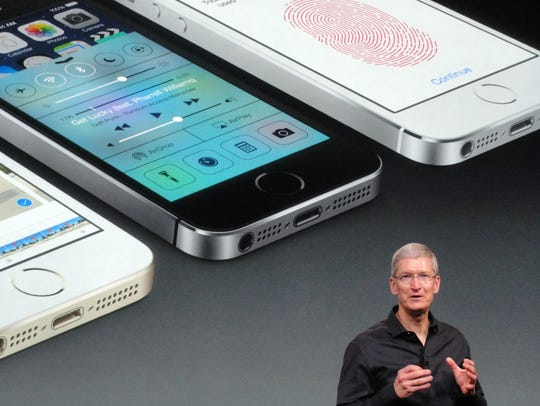Apple chief executive Tim Cook praises the new iPhone