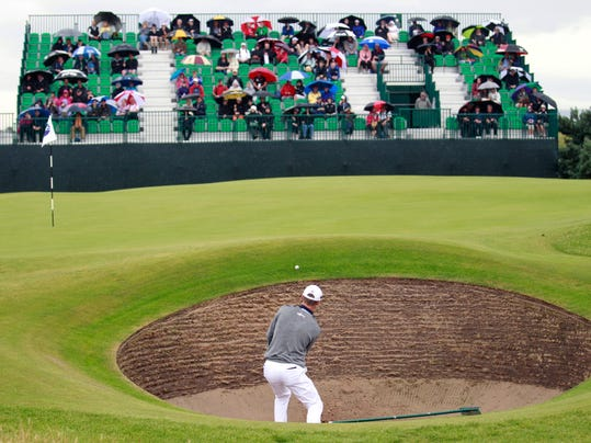 John Senden of Australia plays out of the bunker onto the 6th green during a practice round ahead of the British Open Golf championship at the Royal Liverpool golf club, Hoylake, England, Wednesday July 16, 2014. The British Open Golf championship starts Thursday July 17. (AP Photo/Peter Morrison)