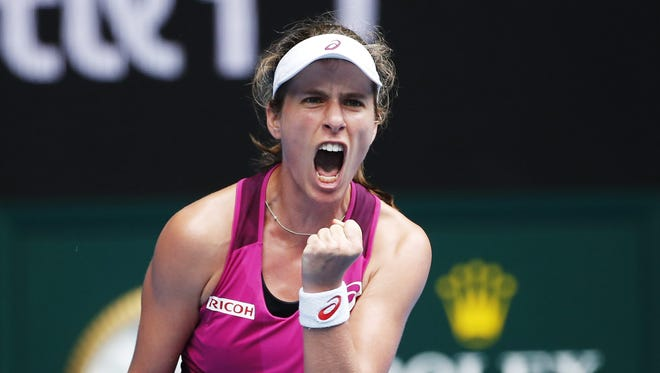 Johanna Konta of Britain celebrates a winner against Shuai Zhang of China during their quarter final match at the Australian Open.