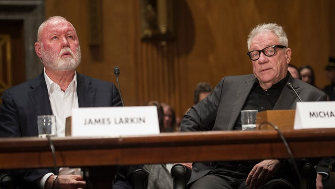 Former Backpage.com owners, James Larkin, (left), and Michael Lacey appear on Capitol Hill in Washington, on  Jan. 10, 2017,  before, the Senate Homeland Security and Governmental Affairs Permanent subcommittee on Investigations hearing into Backpage.com knowing facilitation of online sex trafficking,
