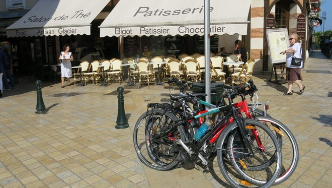 Bikes are parked in front of a cafe in Amboise, France. There are hundreds of miles of bike trails through the chateaux towns of the Loire Valley.