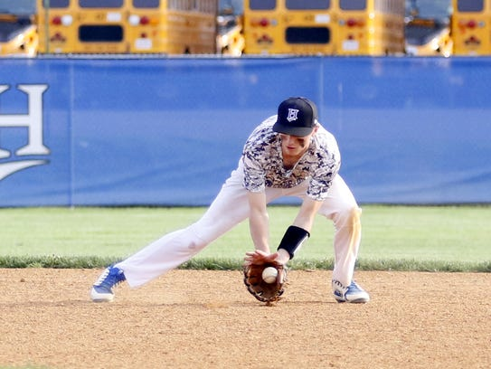 Zachary Goodell of Horseheads looks the ball into his