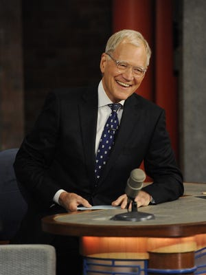 """David Letterman is seen at his desk during the final episode of """"Late Show."""""""