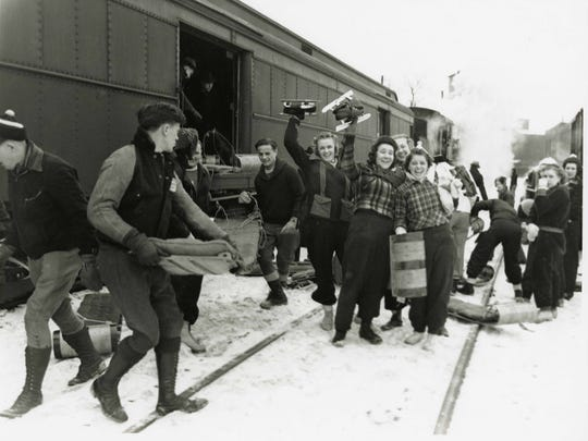 Revelers prepare for St. Cloud's Sli-Ski-Ska Festival, circa 1938. Twin Cities residents traveled aboard the Great Northern Railway to revel in winter activities at the festival, which was hosted from the 1930s to the early 1950s.