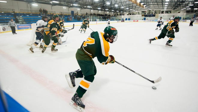 BFA-St. Albans' Sam Shorey (4) looks to pass the puck during the boys hockey game between the BFA-St. Albans Bobwhites and the Essex Hornets last Saturday