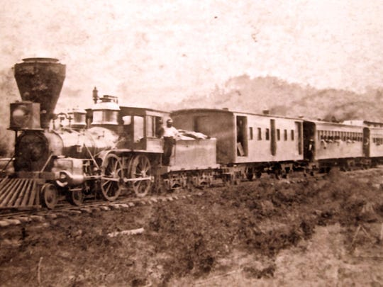 "The Salisbury Engine with passenger cars, or ""varnish,"" approaching Old Fort."