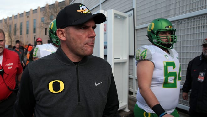 Nov 26, 2016; Corvallis, OR, USA; Oregon Ducks head coach Mark Helfrich and Oregon Ducks offensive lineman Charlie Landgraf (64) walk from the locker room to the field before the game against the Oregon State Beavers at Reser Stadium. Mandatory Credit: Scott Olmos-USA TODAY Sports