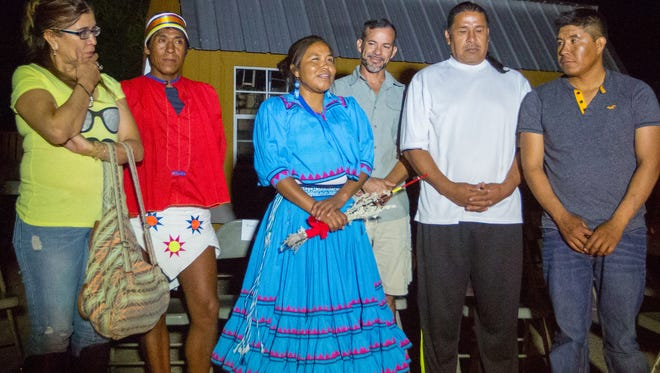 Irma Chavez, center, speaks at a spiritual cleansing ceremony with members of the Tarahumara tribe of Mexico in Las Cruces, Friday, August 26, 2016. To the left of her is runner Arnulfo Quimare and to the right Octavio Casillas, Principal of La Academia Dolores Huerta.