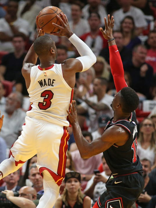 Miami Heat guard Dwyane Wade (3) goes to the basket against Chicago Bulls forward David Nwaba (11) during the first half of an NBA basketball game, Thursday, March 29, 2018, in Miami. (AP Photo/Joel Auerbach)