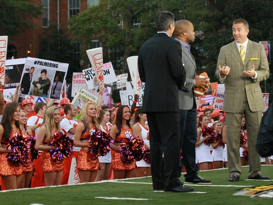 Chris Fowler talks with George Whitfield, Jr., the quarterback guru, and Kirk Herbstreet, at ESPN Gameday at Bowman Field in Clemson.