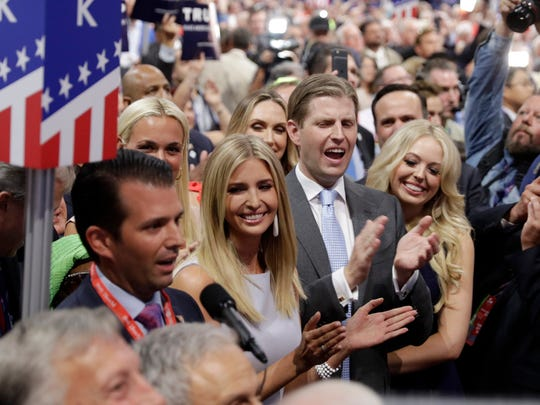 Republican Presidential Candidate Donald Trump's children Donald Trump, Jr., Ivanka Trump, Eric Trump and Tiffany Trump celebrate on the convention floor during the second day session of the Republican National Convention in Cleveland, Tuesday, July 19, 2016.