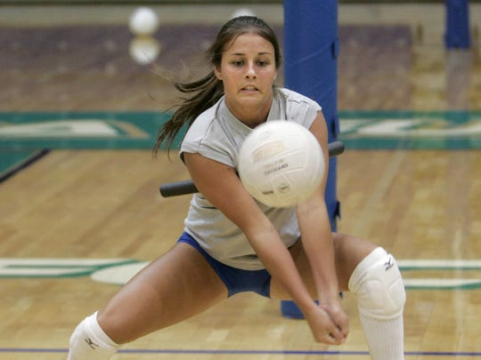 Florida Gulf Coast University volleyball player Brooke Youngquist works on a digging drill during volleyball practice at Alico Arena on Monday Aug. 8, 2005.