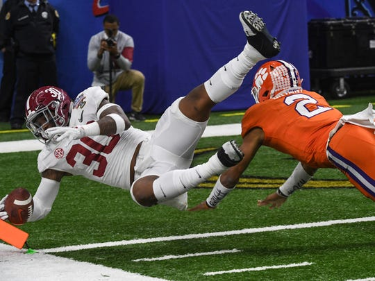 Alabama linebacker Mack Wilson(30) takes an interception into the end zone by Clemson quarterback Kelly Bryant(2) for a touchdown during the third quarter of the Sugar Bowl in the Mercedes-Benz Superdome in New Orleans on Monday.