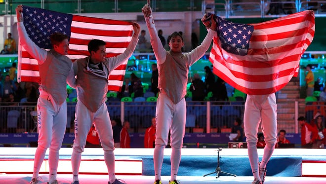 From left to right, Race Imboden, Gerek Meinhardt, Alexander Massialas, Miles Chamley-Watson, celebrates after defeating Italy team in the Bronze medal men's team foil competition at the 2016 Summer Olympics in Rio de Janeiro, Brazil, Friday, Aug. 12, 2016.