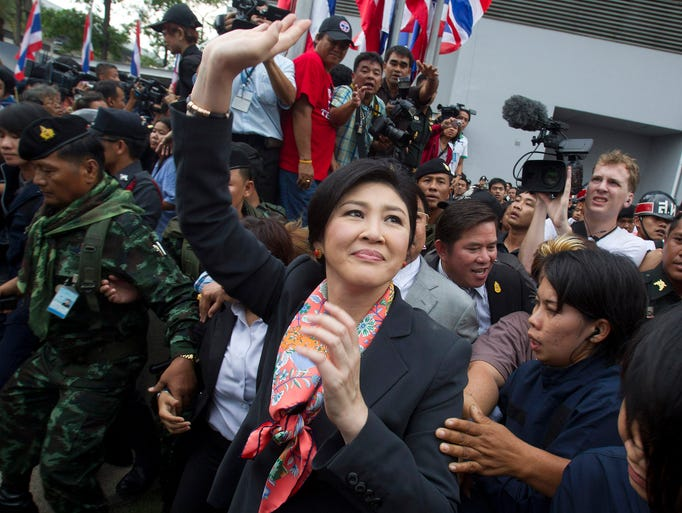 Thai Prime Minister Yingluck Shinawatra waves to supporters on May 7 in Bangkok. A court ordered the prime minister to step down in a ruling that handed a victory to anti-government protesters who have staged six months of street protests.
